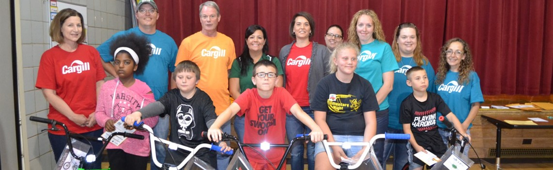Fourth grade students with perfect attendance earned bikes from Cargill.